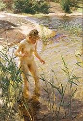 Bild på  kvinna som vadar i vatten